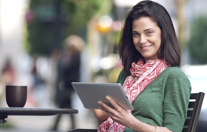Smiling woman with tablet computer