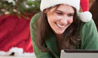 Woman using laptop at Christmas. Image shot 2009. Exact date unknown.