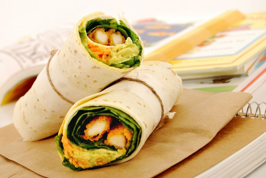 43567848 - school lunch of fried chicken & avocado wrap sandwich