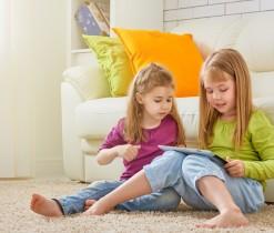 42500125 - happy children holding digital tablet