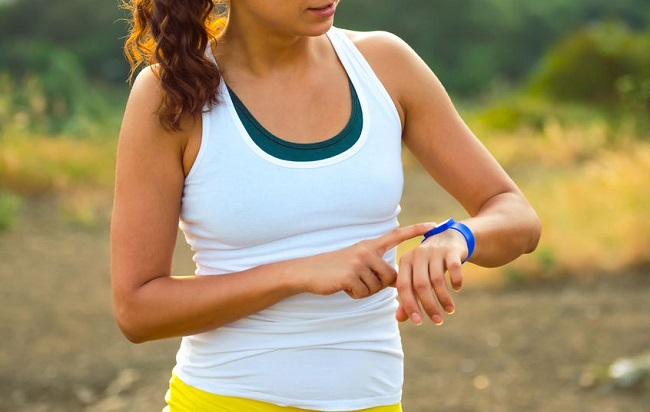 43589875 - woman using activity tracker. outdoor fitness concept